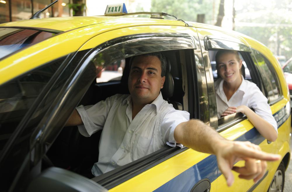 Taxis typically use radios to communicate with a dispatcher.