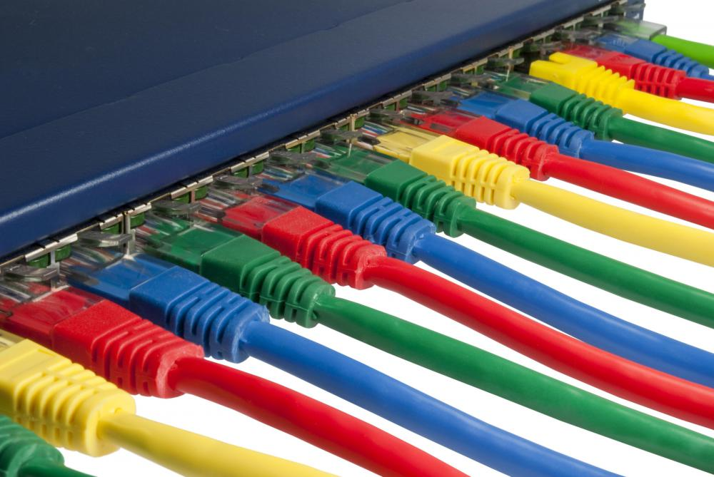 Ethernet cables plugged into an Internet switch.
