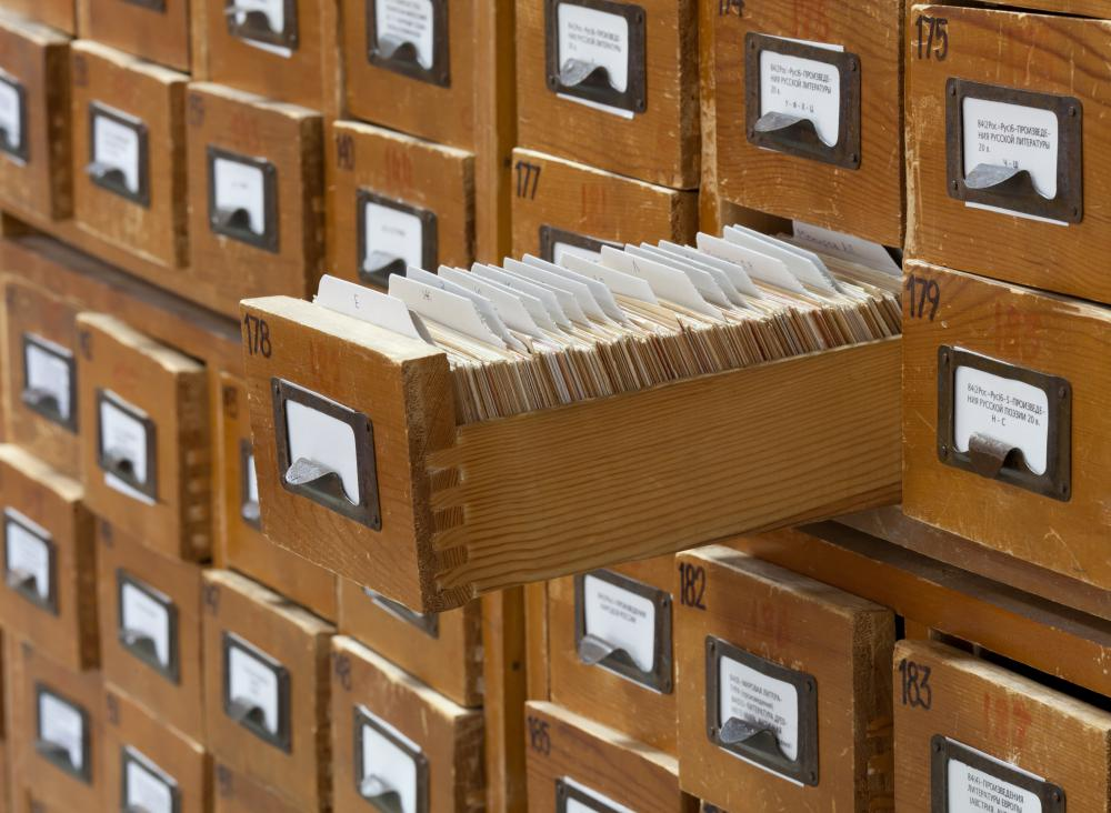In most libraries, old fashioned card catalogs have been replaced with computer systems.