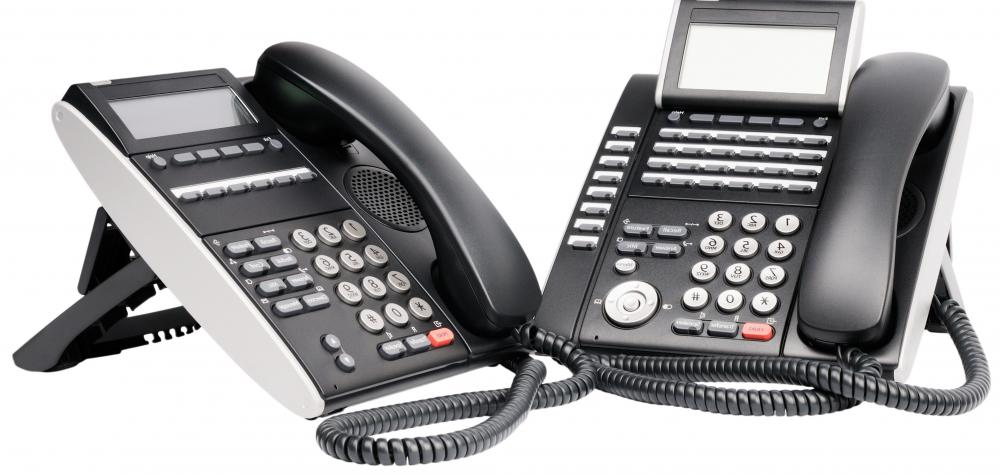 Phones with conference calling features are used in business.