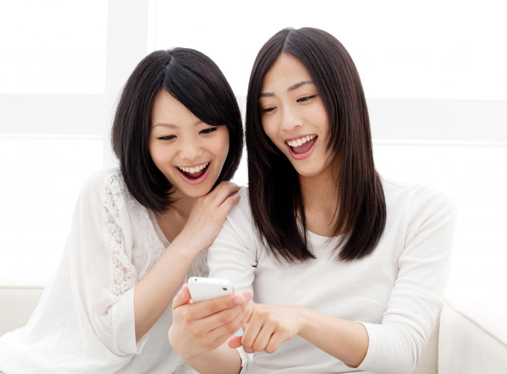 Facebook friends may communicate using cell phones or other mobile devices.